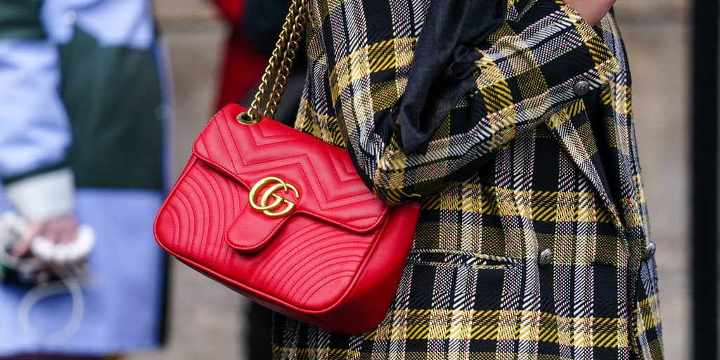 A woman wears a red quilted Gucci bag in Paris